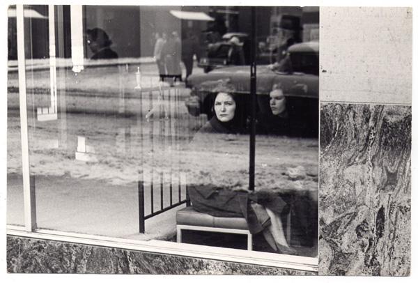 Seated  women thru window