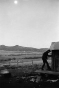 man entering outhouse