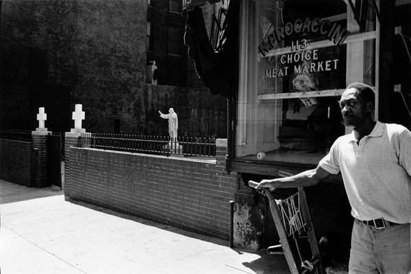 Crosses, statue and wise man, Bleeker Street
