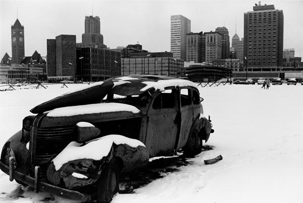 City snowscape with junk car