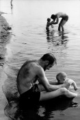 Man and child in lake water, Lake Nikomis, Mpls, 1963