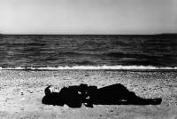 Woman sleeping at lakefront