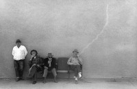 Smokers on bench, Columbia Fall, Mont. 1963