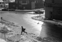 Boy crossing the street